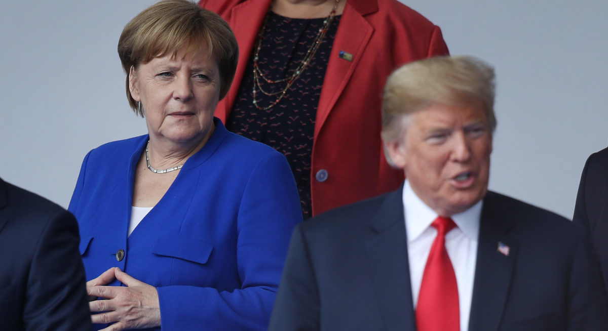 BRUSSELS, BELGIUM - JULY 11: German Chancellor Angela Merkel and U.S. President Donald Trump attend the opening ceremony at the 2018 NATO Summit at NATO headquarters on July 11, 2018 in Brussels, Belgium. Leaders from NATO member and partner states are meeting for a two-day summit, which is being overshadowed by strong demands by U.S. President Trump for most NATO member countries to spend more on defense. (Photo by Sean Gallup/Getty Images)