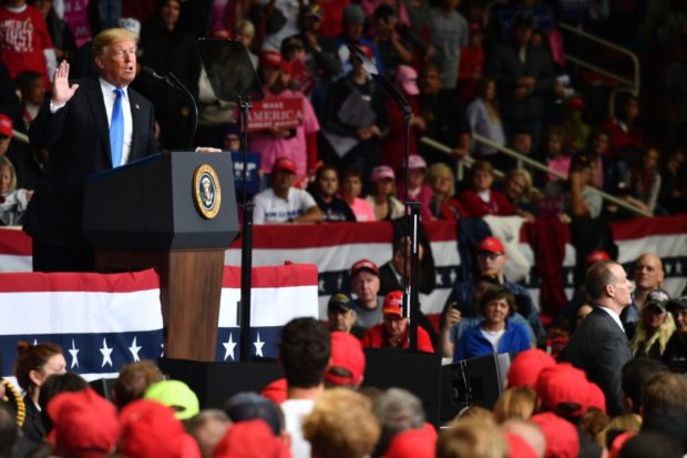 """US President Donald Trump addresses a """"Make America Great Again"""" rally at Bojangles' Coliseum on October 26, 2018 in Charlotte, North Carolina. (NICHOLAS KAMM/AFP/Getty Images)"""