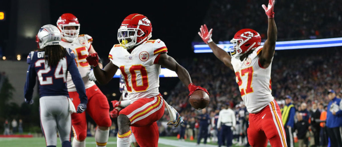 FOXBOROUGH, MA - OCTOBER 14: Tyreek Hill #10 of the Kansas City Chiefs celebrates a touchdown pass with Kareem Hunt #27 of the Kansas City Chiefs against the New England Patriots in the fourth quarter at Gillette Stadium on October 14, 2018 in Foxborough, Massachusetts. (Photo by Jim Rogash/Getty Images)