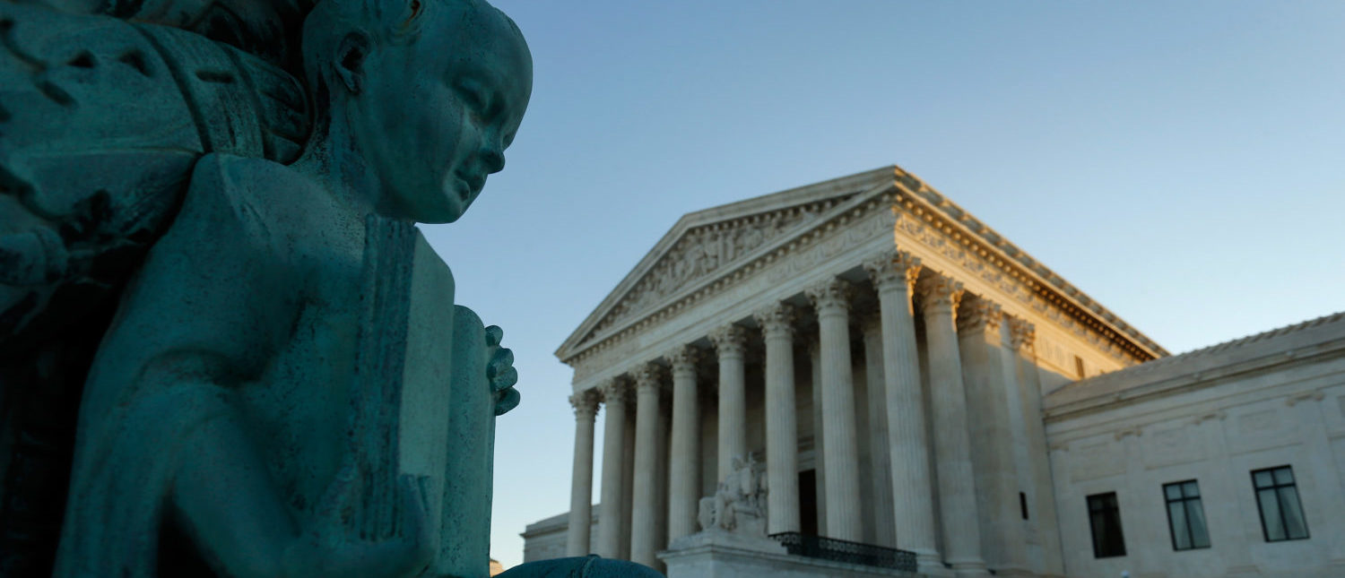 A figure of a child holding an open book decorates a flagpole at the U.S. Supreme Court building in Washington October 5, 2014. The U.S. Supreme Court opens on Monday a new term in which the nine justices will decide issues such as whether a Muslim prison inmate can have a beard and whether a man can be prosecuted for making threatening statements on Facebook. REUTERS/Jonathan Ernst