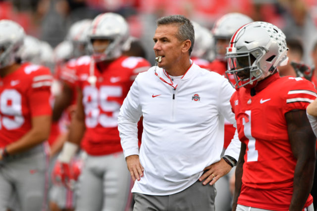COLUMBUS, OH - SEPTEMBER 22: Head Coach Urban Meyer of the Ohio State Buckeyes watches as his team warms up before a game against the Tulane Green Wave at Ohio Stadium on September 22, 2018 in Columbus, Ohio. (Photo by Jamie Sabau/Getty Images)