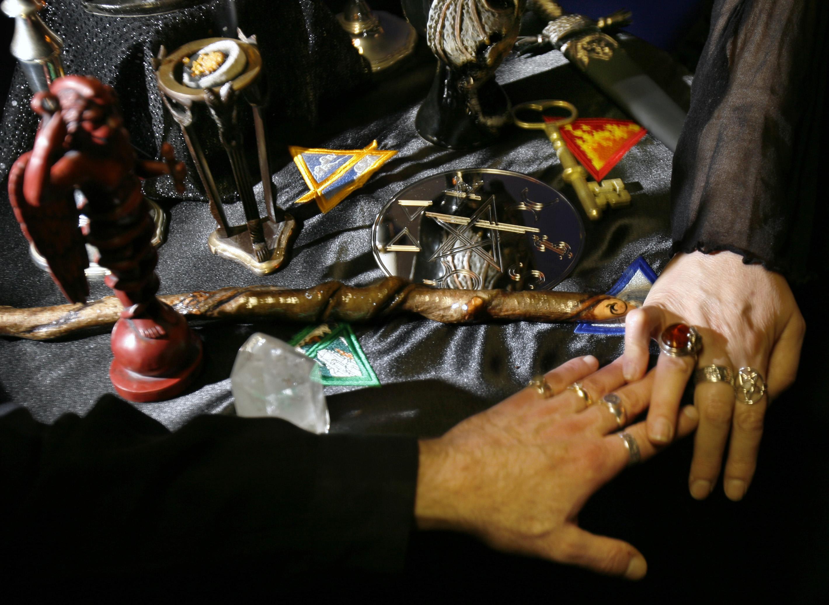 "High priestess and priest Richard (L) and Gypsy Ravish hold hands at an altar dedicated to ""magick and the return of the old ways"" at their store Nu Aeon in Salem, Massachusetts October 25, 2006. Witches of Salem will celebrate the Wiccan new year of Samhain on October 31. REUTERS/Brian Snyder"