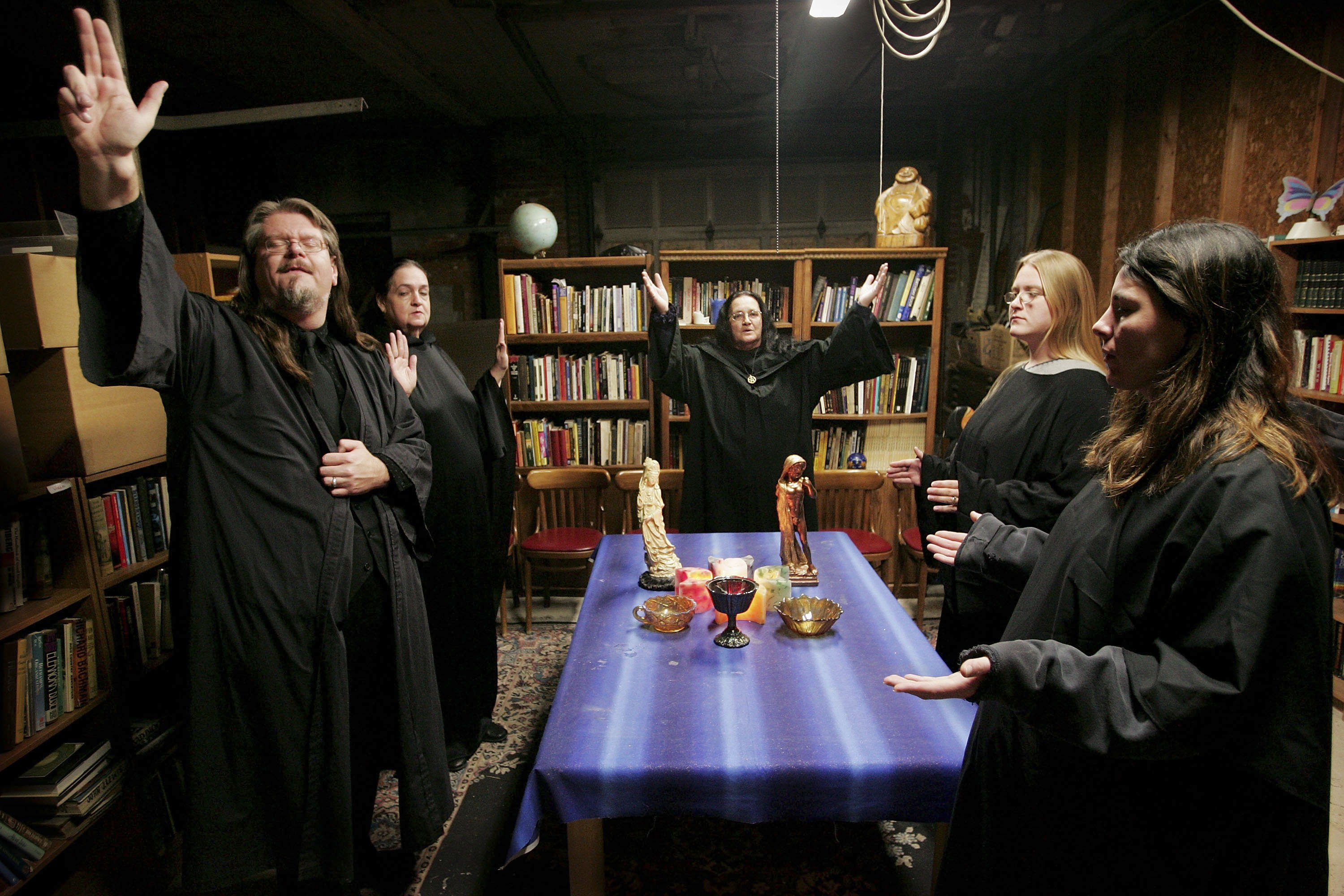 Wicca religion practitioners (L-R) Rev. Don Lewis, Rev. Krystal High-Correll, and Rev. Virgina Powell HPS and student Ashleigh Powell and Cathy Smith participate in a Wiccan Lunar ritual in the temple at the Witch School October 25, 2006 in Hoopeston, Illinois. Wicca is a neo-Pagan religion which uses magic and nature in its teachings. The school, which opened in 2003, offers courses in Wicca theology, hosts seminars and Wiccan rituals at the campus. (Photo by Scott Olson/Getty Images)