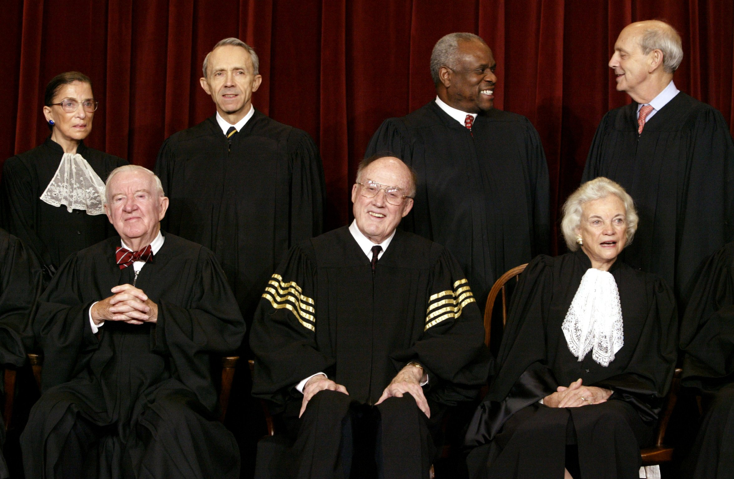 Chief Justice William Rehnquist, bottom row at center, seated next to Justice Sandra Day O'Connor in 2003. (Reuters)