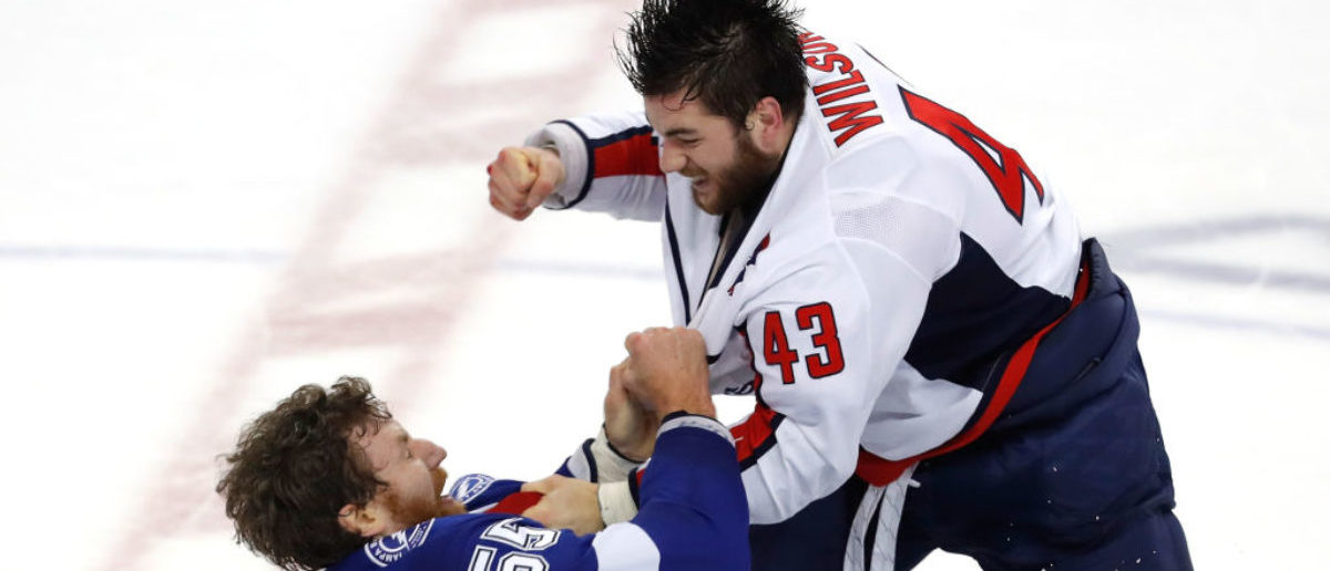 TAMPA, FL - MAY 23: Braydon Coburn #55 of the Tampa Bay Lightning fights with Tom Wilson #43 of the Washington Capitals during the first period in Game Seven of the Eastern Conference Finals during the 2018 NHL Stanley Cup Playoffs at Amalie Arena on May 23, 2018 in Tampa, Florida. (Photo by Mike Carlson/Getty Images)