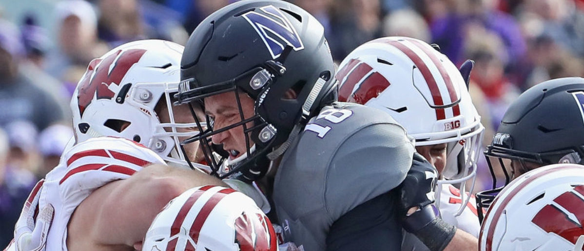 EVANSTON, IL - OCTOBER 27: Clayton Thorson #18 of the Northwestern Wildcats is stood up short of the goal line by members of the Wisconsin Badgers defense including T.J. Edwards #53 and Andrew Van Ginkel #17 at Ryan Field on October 27, 2018 in Evanston, Illinois. (Photo by Jonathan Daniel/Getty Images)