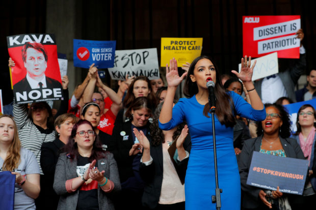 Democratic Congressional candidate Alexandria Ocasio-Cortez speaks at a really against Supreme Court nominee Brett Kavanaugh outside an expected speech by U.S. Representative Jeff Flake (R-AZ) in Boston, U.S., October 1, 2018. REUTERS/Brian Snyder