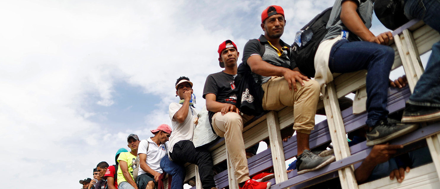 Honduran migrants, part of a caravan trying to reach the U.S., are pictured on a truck during a new leg of their travel in Chiquimula , Guatemala October 16, 2018. REUTERS/Edgard Garrido