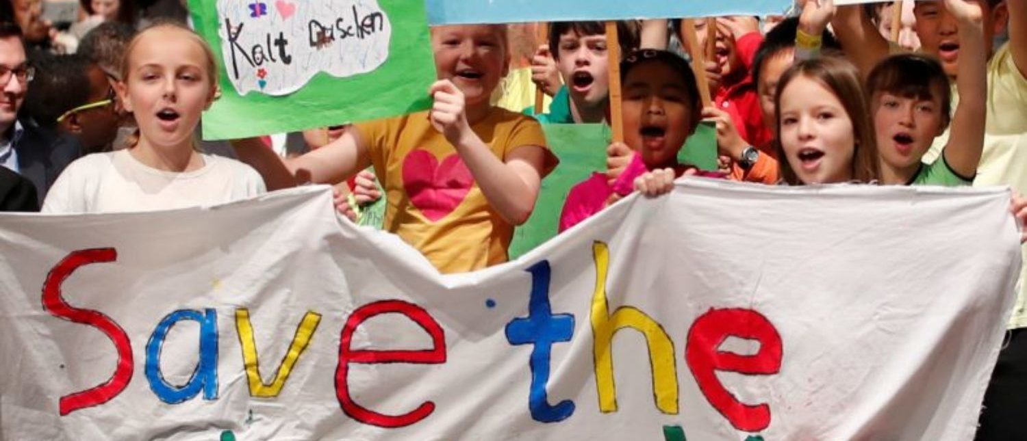 FILE PHOTO: Children are seen during climate march prior to the opening session of the COP23 UN Climate Change Conference 2017, hosted by Fiji but held in Bonn, in World Conference Center Bonn, Germany, November 6, 2017. REUTERS/Wolfgang Rattay/File Photo
