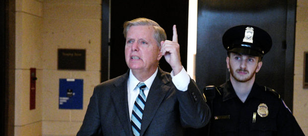U.S. Senator Lindsey Graham (R-SC) gestures to reporters as he arrives to speak about the FBI's investigation of sexual assault allegations surrounding U.S. Supreme Court nominee Brett Kavanaugh on Capitol Hill in Washington, U.S., October 4, 2018. REUTERS/Mary F. Calvert