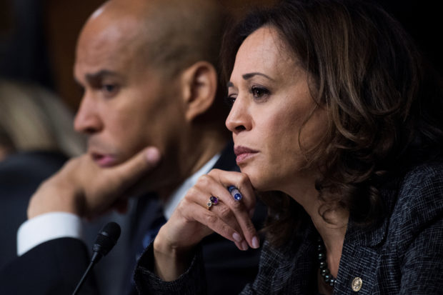 Sen. Cory Booker, D-N.J., and Sen. Kamala Harris, D-Calif., listen as Dr. Christine Blasey Ford testifies during the Senate Judiciary Committee hearing on the nomination of Brett M. Kavanaugh to be an associate justice of the Supreme Court of the United States, focusing on allegations of sexual assault by Kavanaugh against Christine Blasey Ford in the early 1980s, in Washington, DC, U.S., September 27, 2018. Picture taken September 27, 2018. Tom Williams/Pool