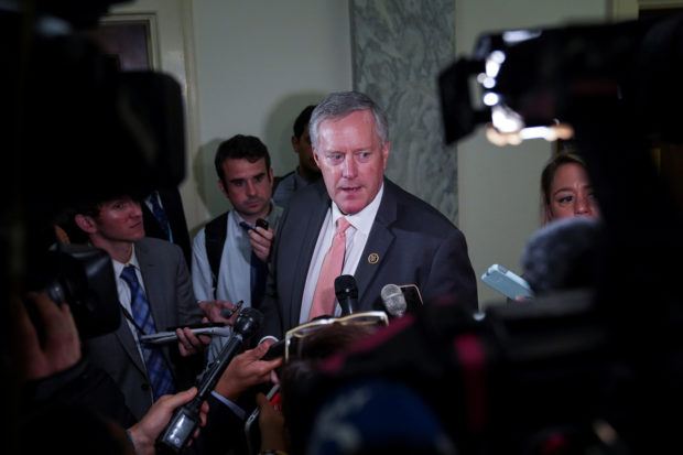 Rep. Mark Meadows (R-NC), member of the House Judiciary Committee, takes questions from the press as FBI agent Peter Strzok meets with the House Judiciary Committee at the Rayburn House Office Building in Washington, U.S., June 27, 2018. REUTERS/Toya Sarno Jordan