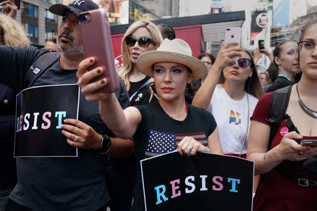 Actress Alyssa Milano attends a protest against U.S. President Donald Trump's announcement that he plans to reinstate a ban on transgender individuals from serving in any capacity in the U.S. military, in Times Square, in New York City, New York, U.S., July 26, 2017. REUTERS/Carlo Allegri