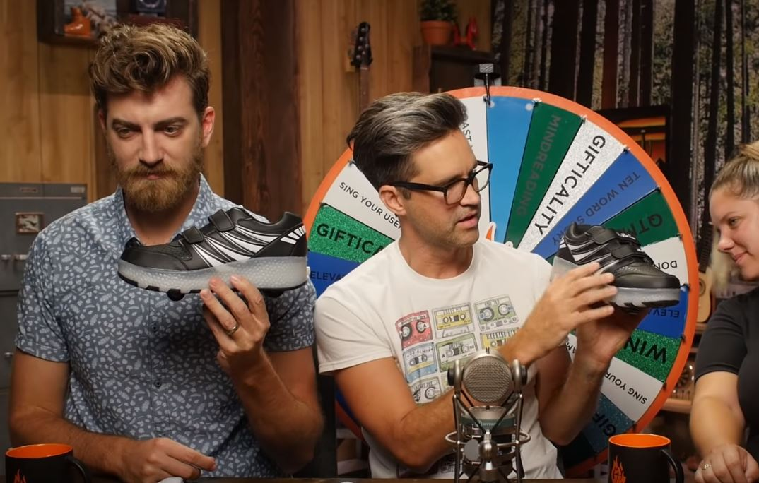 YouTube personalities Rhett and Link examine shoes bought from Chinese company Wish.com in a video posted Oct. 5, 2018. YouTube screenshot/