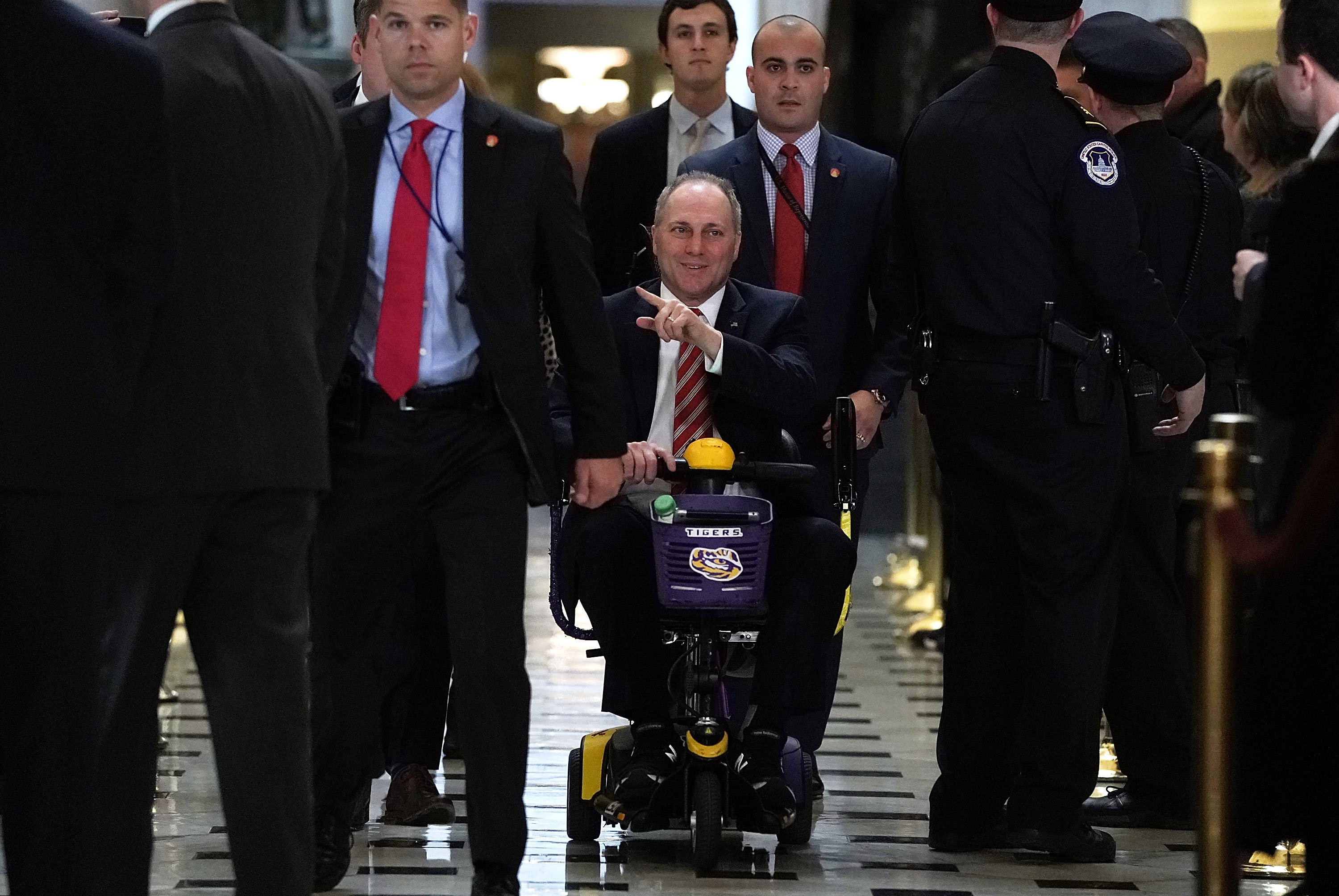 WASHINGTON, DC - DECEMBER 19: U.S. House Majority Whip Rep. Steve Scalise (R-LA) (C) heads towards the House chamber to vote on the tax overhaul bill December 19, 2017 at the Capitol in Washington, DC. The House has passed the tax overhaul bill and the Senate is expected to vote on the bill soon. (Photo by Alex Wong/Getty Images)