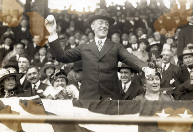 Woodrow Wilson throws a baseball on Opening Day, 1916/ Shutterstock