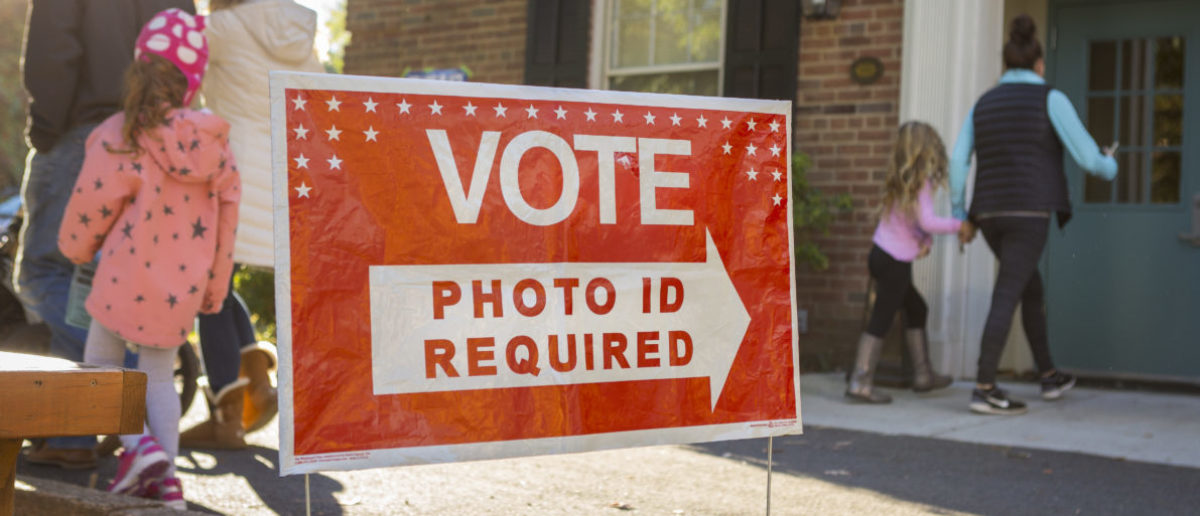 Voter ID Required Sign At Ballot Box. shutterstock_512254585