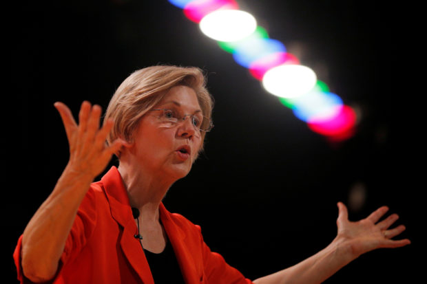 FILE PHOTO: U.S. Senator Elizabeth Warren (D-MA) holds a town hall meeting in Revere, Massachusetts, U.S., Aug. 4, 2017. REUTERS/Brian Snyder