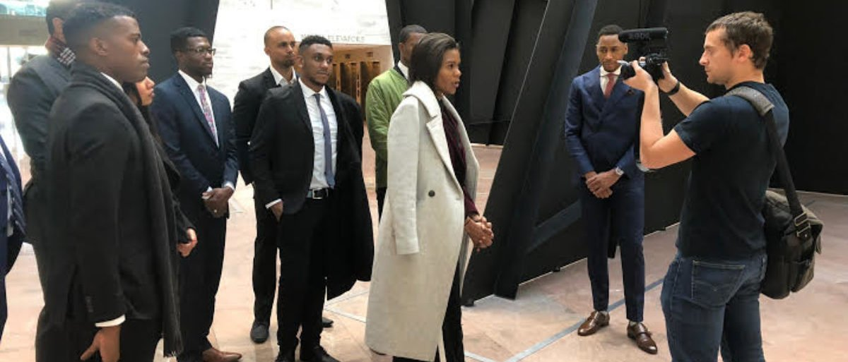 """Candace Owens speaks to a reporter in the Hart Senate Office Building on Wednesday, Nov. 28. She and a group of other African-American conservatives lobbied senators in favor of the """"First Step Act."""" (Photo by Jon Brown/TheDC)"""