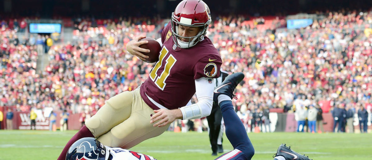LANDOVER, MD - NOVEMBER 18: Alex Smith #11 of the Washington Redskins is tackled by Justin Reid #20 of the Houston Texans in the first half at FedExField on November 18, 2018 in Landover, Maryland. (Photo by Patrick McDermott/Getty Images)