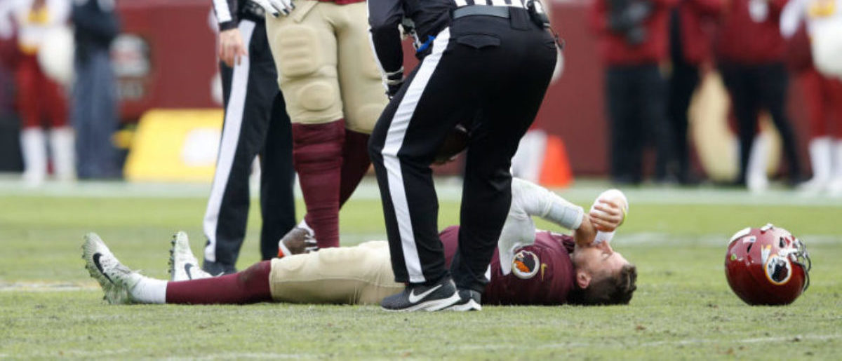 LANDOVER, MD - NOVEMBER 18: Alex Smith #11 of the Washington Redskins lays on the field after being sacked and injured by Kareem Jackson #25 of the Houston Texans in the third quarter of the game at FedExField on November 18, 2018 in Landover, Maryland. (Photo by Joe Robbins/Getty Images)