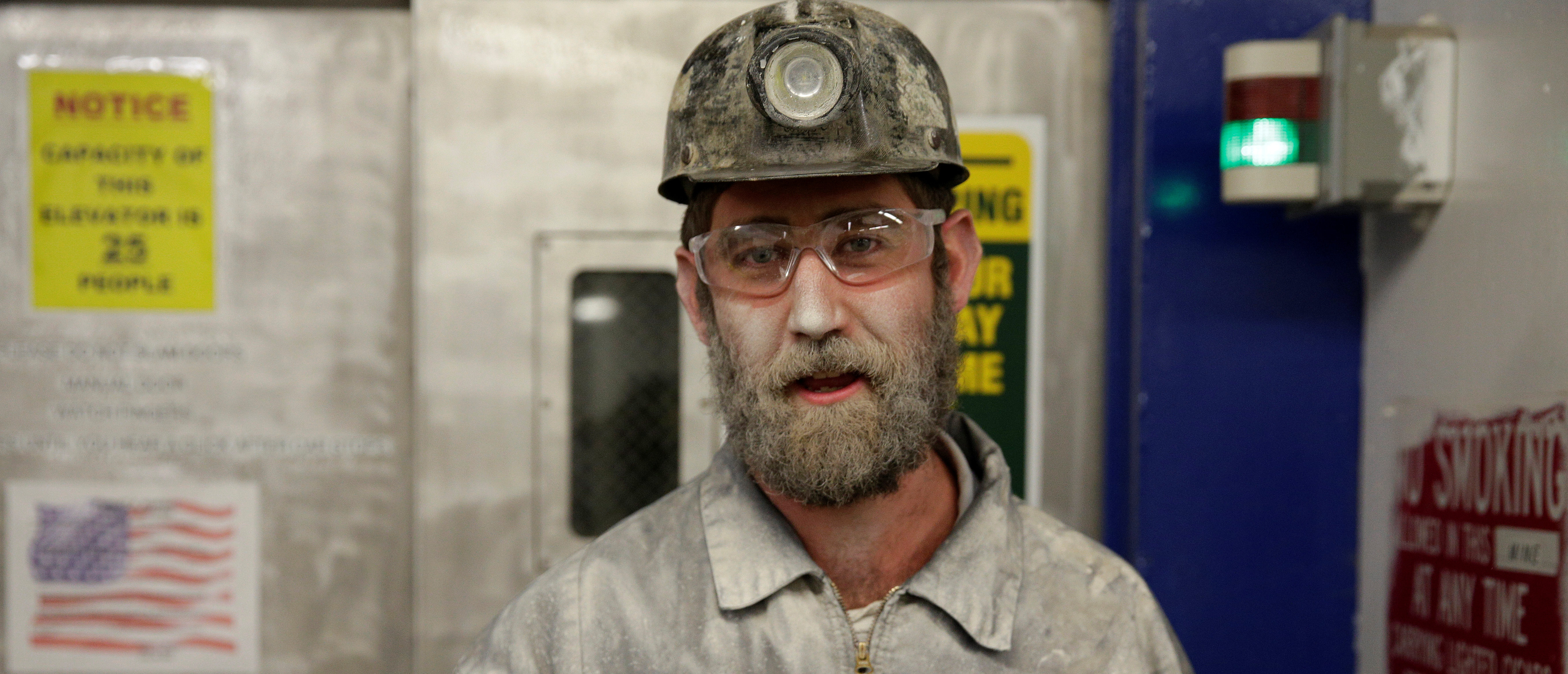 Brian Tingler, 38, stands covered in dust after his shift at the American Energy Corporation Century Mine in Beallsville, Ohio, November 7, 2017. REUTERS/Joshua Roberts