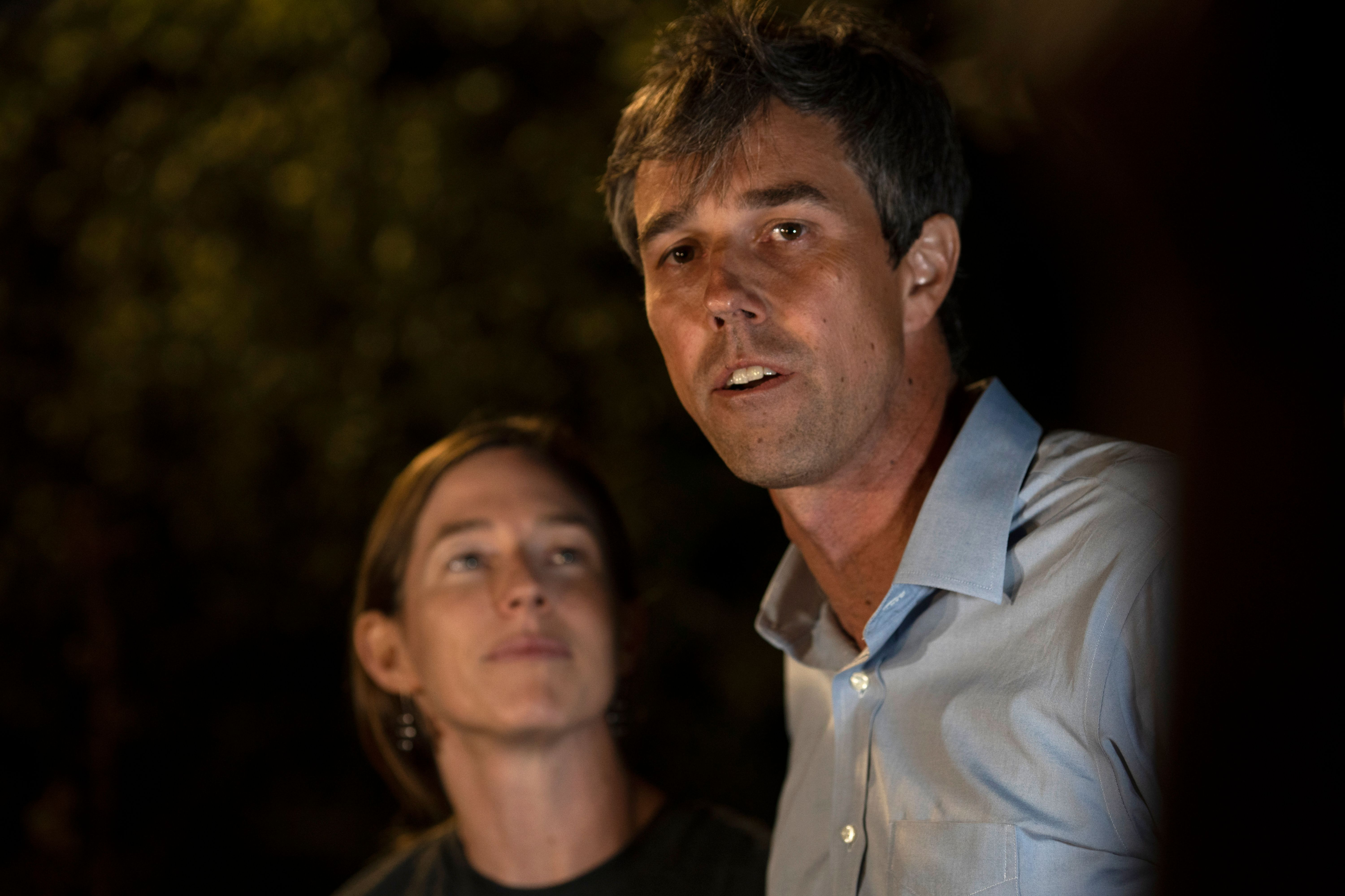 Democratic Party Candidate Beto O'Rourke greets the press with his wife, Amy Hoover Sanders (L), outside of the University of Texas in El Paso, Texas on November 5, 2018. (PAUL RATJE/AFP/Getty Images)