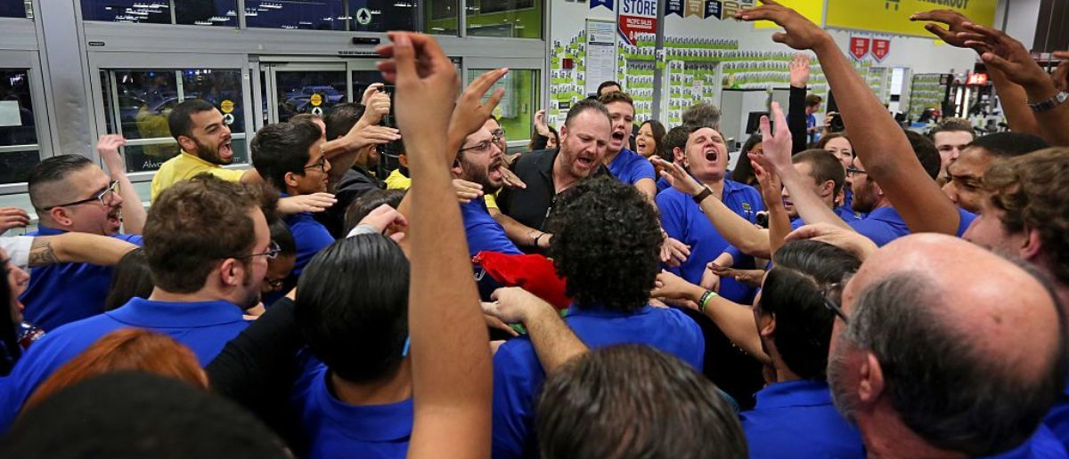 SAN DIEGO, CA - NOVEMBER 26: Employees engage in a group cheer before opening their doors to shoppers at a Best Buy on November 26, 2015 in San Diego, California. Although Black Friday sales are expected to be strong, many shoppers are opting to buy online or retailers are offering year round sales and other incentives that are expected to ease crowds. (Photo by Sandy Huffaker/Getty Images)