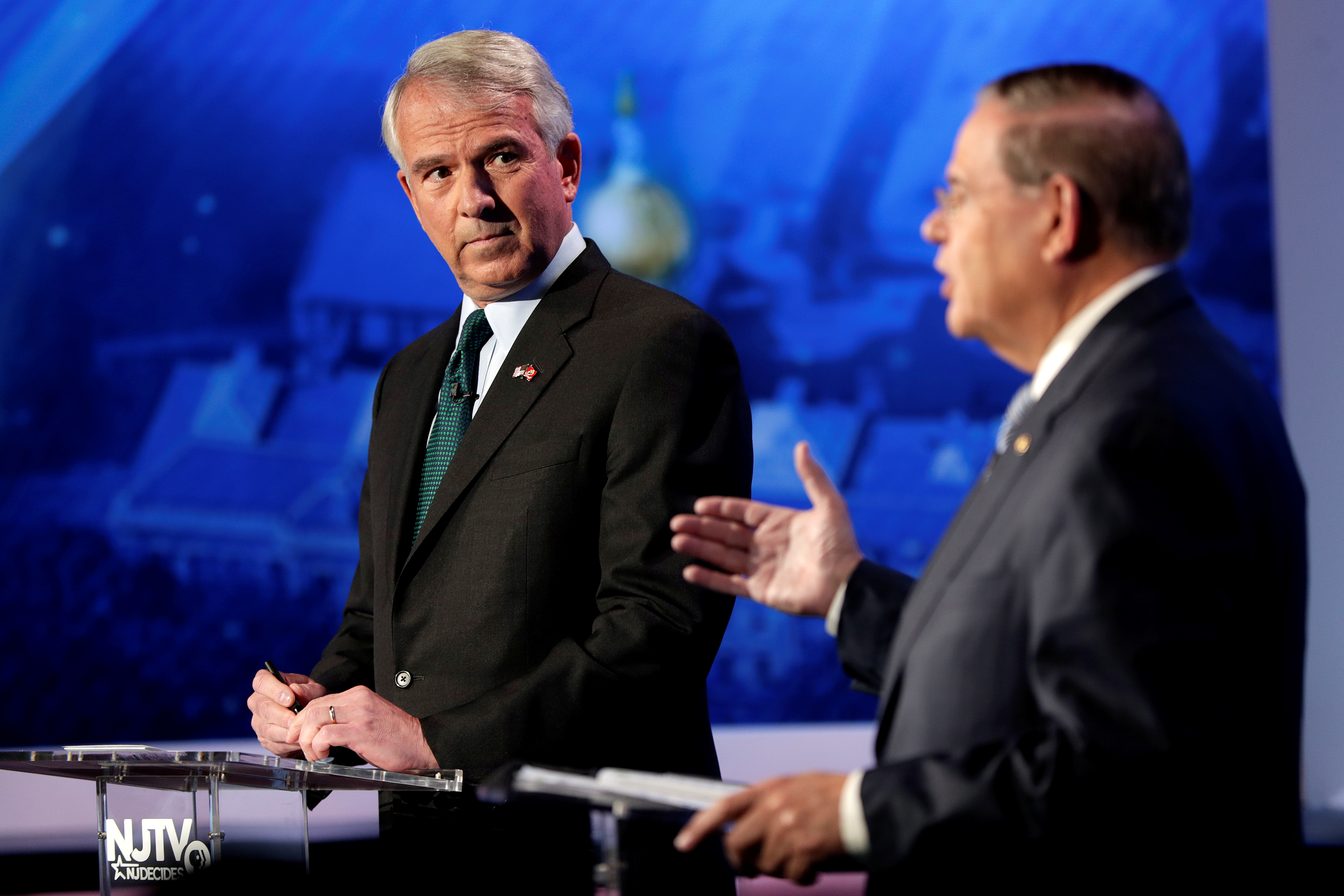 New Jersey Senator Bob Menendez answers a question as Republican Bob Hugin looks on during a debate in Newark, New Jersey. Julio Cortez/Pool via Reuters