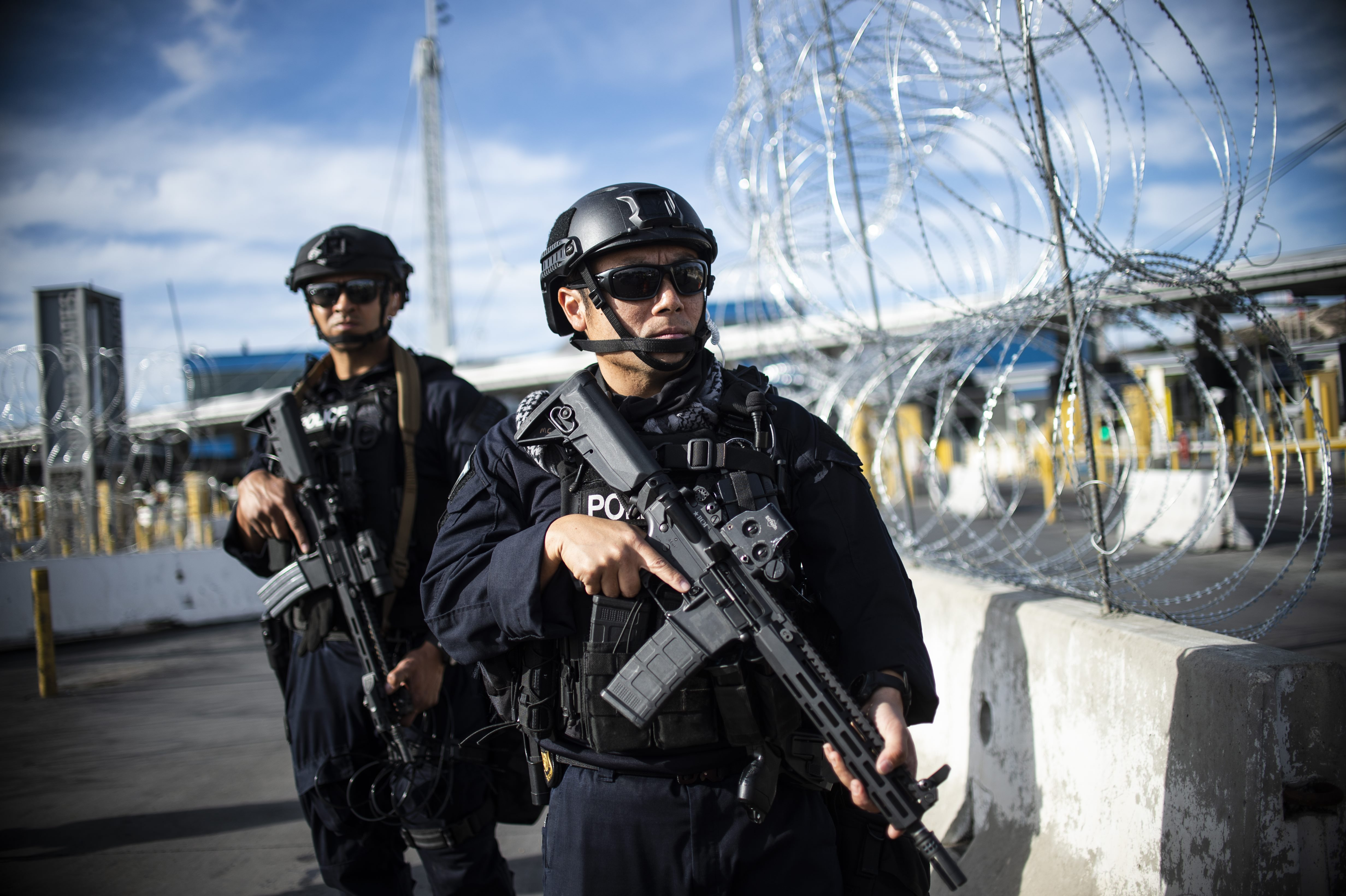 TOPSHOT - US Customs and Border Protection (CBP) take part in a operational readiness exercise at the San Ysidro port of entry in the US, as seen from Tijuana, Baja California State, Mexico, on November 22, 2018 as thousands of Central American migrants -mostly Hondurans- have started arriving at the Mexico-US border. (PEDRO PARDO/AFP/Getty Images)