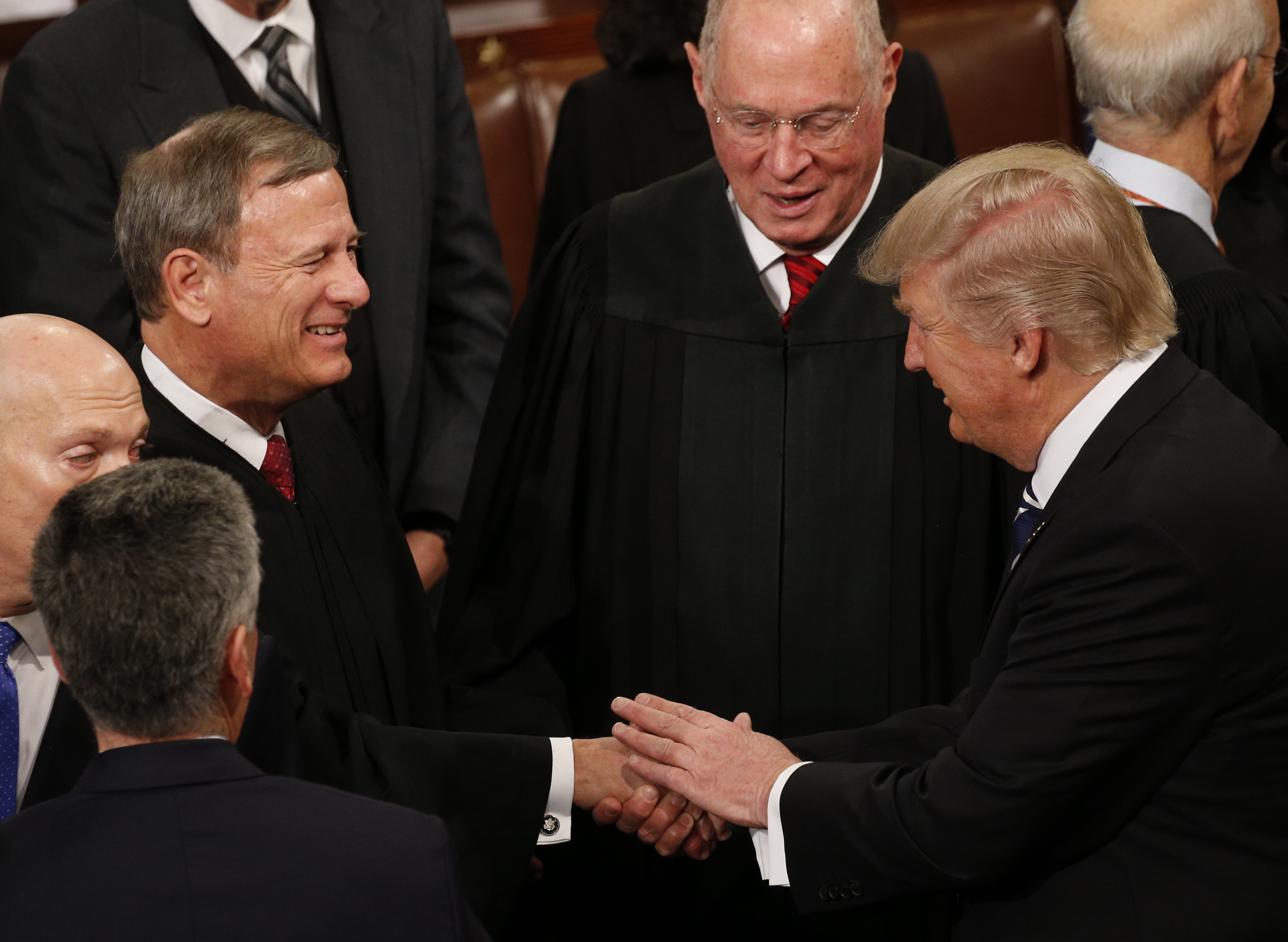 President Donald Trump shakes hands with Chief Justice John Roberts after addressing the U.S. Congress. REUTERS/Kevin Lamarque
