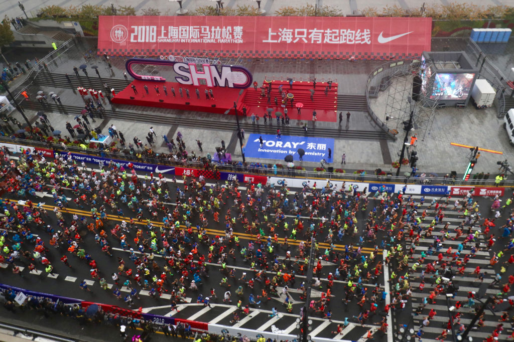 Runners take part in the Shanghai International Marathon in Shanghai on November 18, 2018. (Photo by - / AFP) / China OUT (Photo credit should read -/AFP/Getty Images)