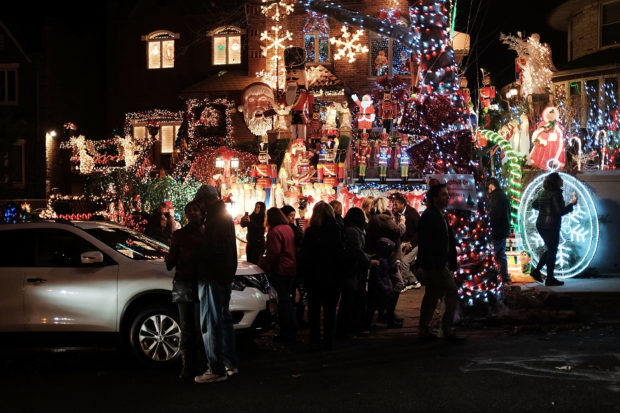 BROOKLYN, NY - DECEMBER 15: Christmas lights and other ornaments decorate a home on December 15, 2015 in the Dyker Heights neighborhood of the Brooklyn borough of New York City. Brooklyn, one of the most culturally and ethnically diverse areas in the nation, hosts numerous neighborhoods where Christmas tree lights have become a significant attraction with hundreds of cars and pedestrians arriving daily to view the homes. The Dyker Heights neighborhood has become the most popular area for Christmas lights viewing. (Photo by Spencer Platt/Getty Images)