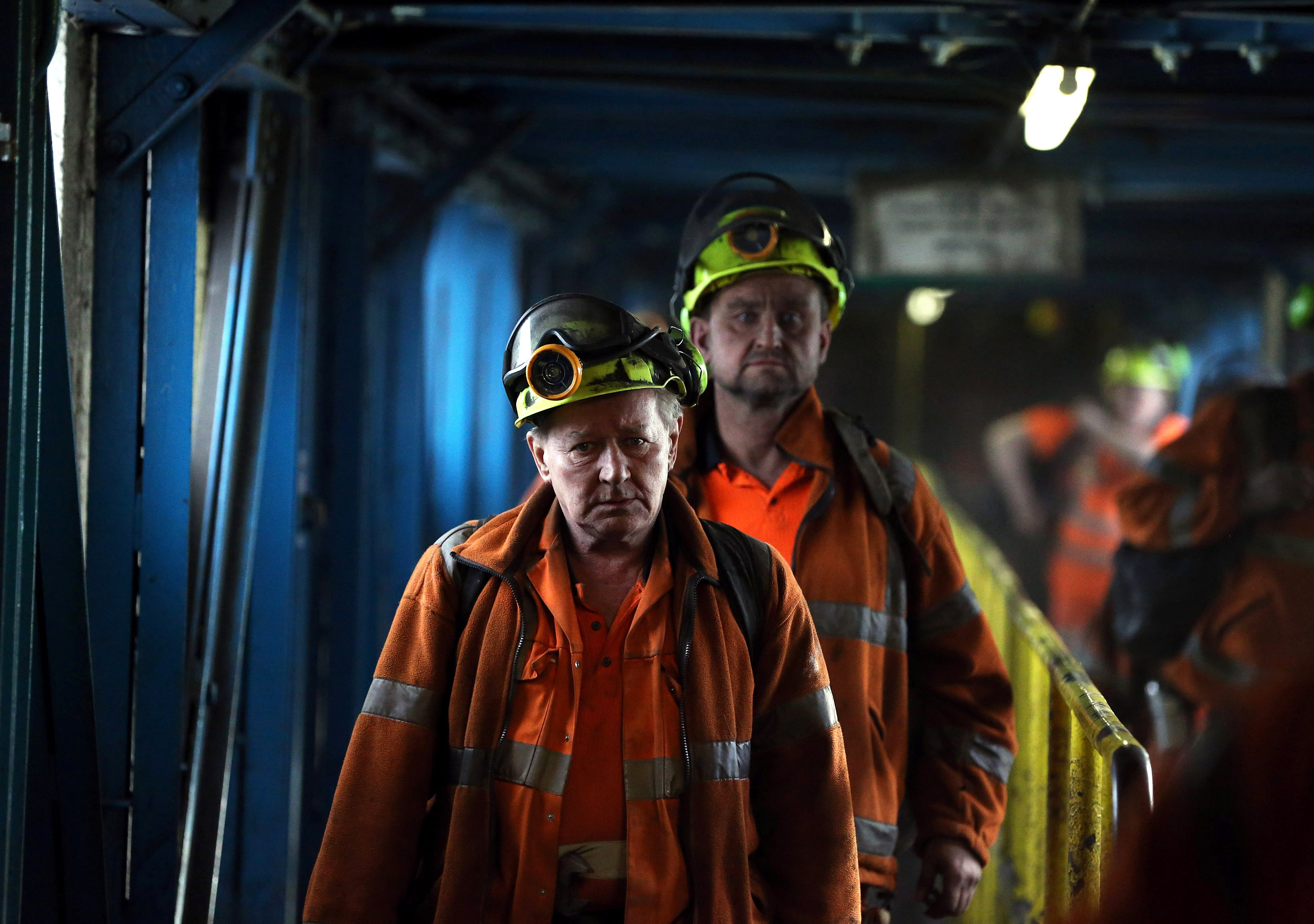 Miners leave after working the final shift at Kellingley Colliery on its last day of operation in north Yorkshire, England