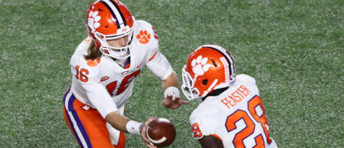 CHESTNUT HILL, MA - NOVEMBER 10: Quarterback Trevor Lawrence #16 of the Clemson Tigers hands off to Tavien Feaster #28 of the Clemson Tigers during the third quarter of the game against the Boston College Eagles at Alumni Stadium on November 10, 2018 in Chestnut Hill, Massachusetts. (Photo by Omar Rawlings/Getty Images)