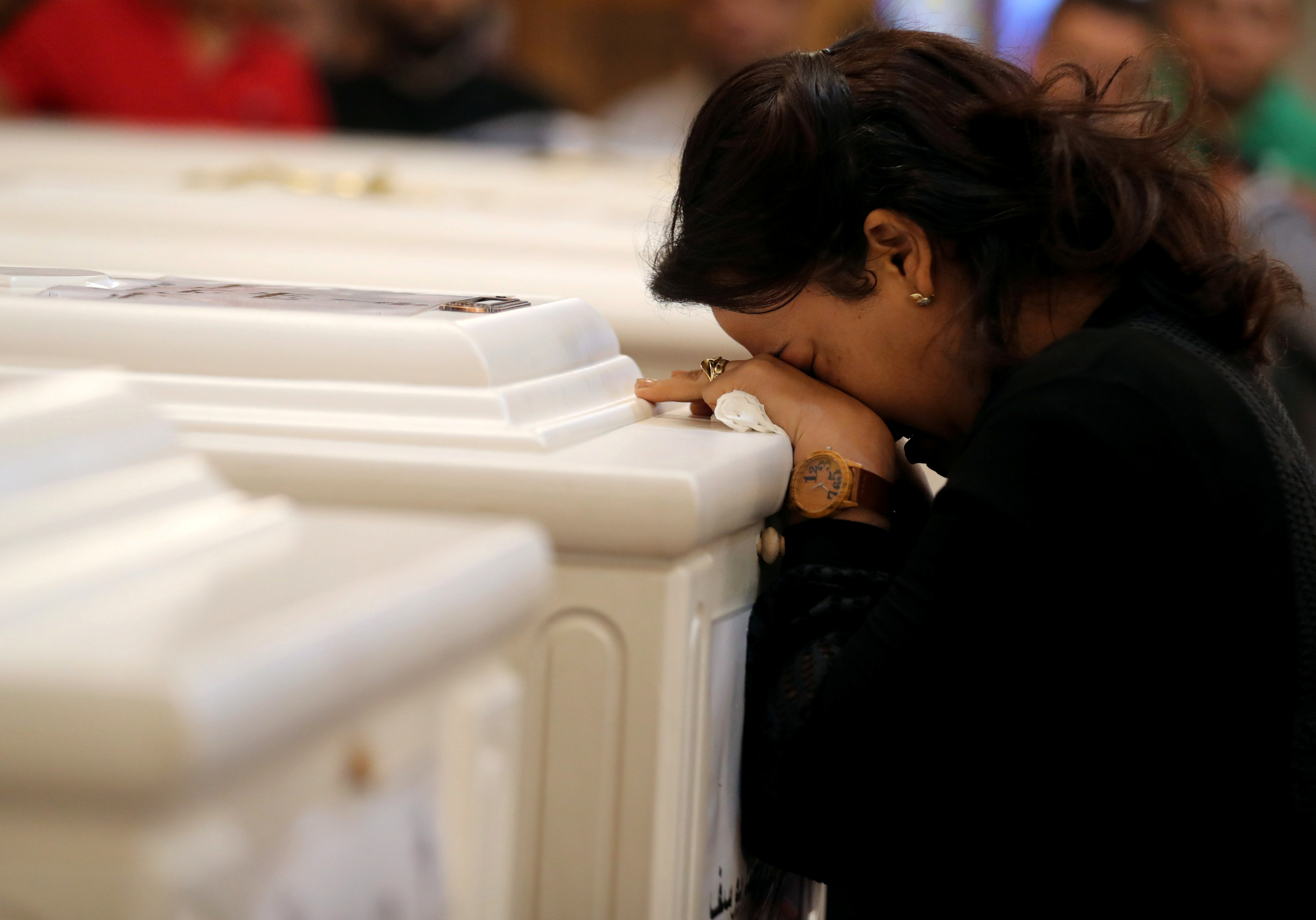 A relative of victims of an attack on a group of Coptic Christians attends a funeral, at the Prince Tadros Church in Minya, Egypt, November 3, 2018. REUTERS/Mohamed Abd El Ghany