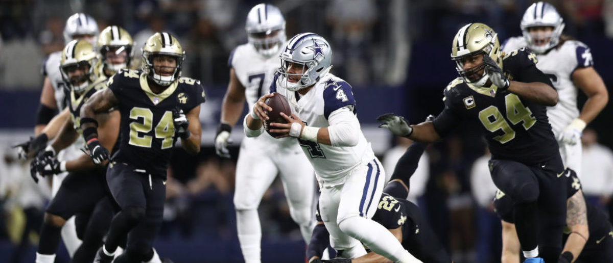 ARLINGTON, TEXAS - NOVEMBER 29: Dak Prescott #4 of the Dallas Cowboys runs for a first down against the New Orleans Saints in the fourth quarter at AT&T Stadium on November 29, 2018 in Arlington, Texas. (Photo by Ronald Martinez/Getty Images)