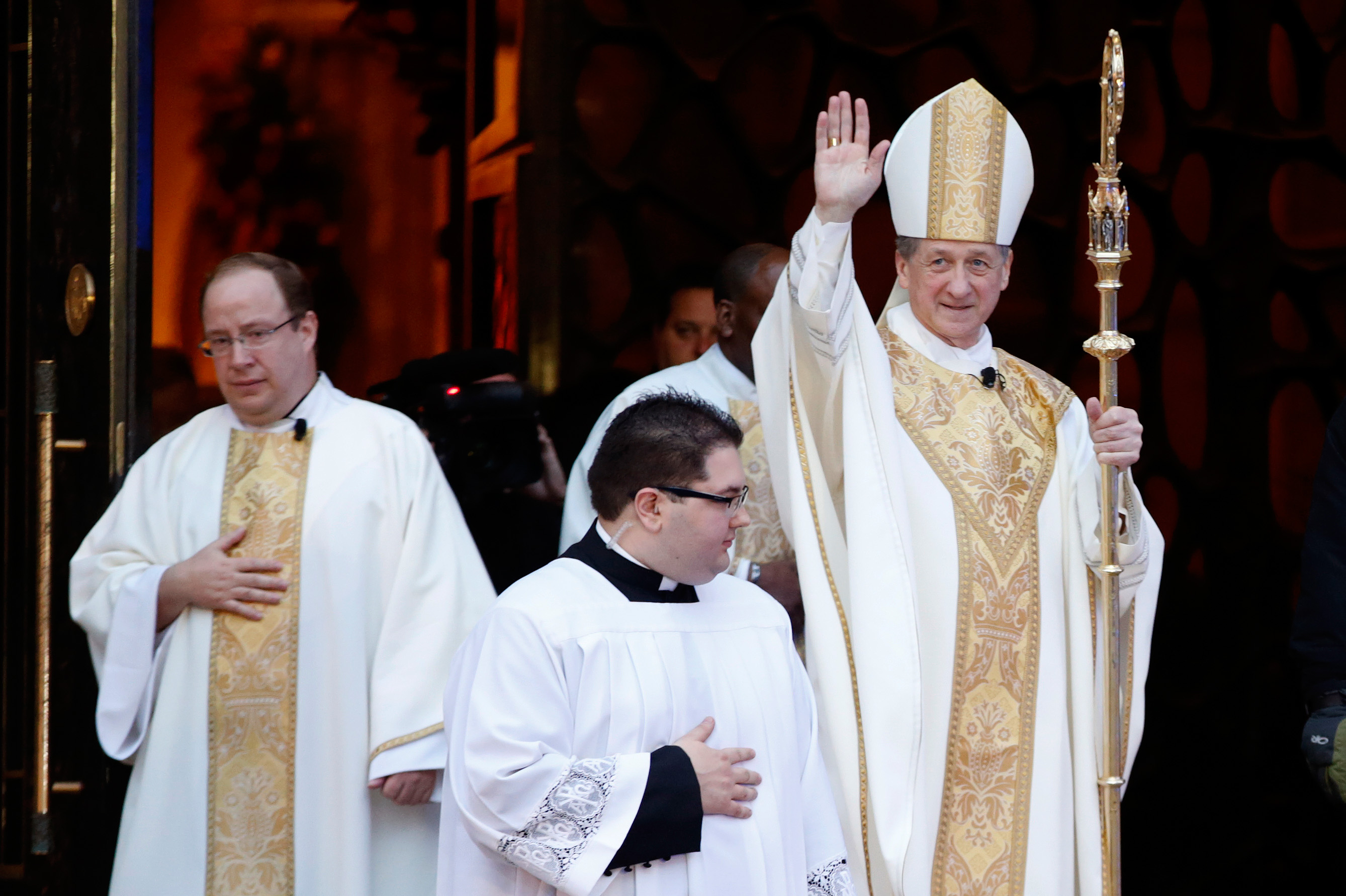 Bishop Blase Cupich, Pope Francis' first major appointment in the hierarchy of the U.S. Catholic Church, exits Holy Name Cathedral after his installation as the new archbishop in Chicago November 18, 2014. Cupich, 65, who is seen as a moderate, succeeds the more conservative Cardinal Francis George, 77, who is retiring. REUTERS/Andrew Nelles