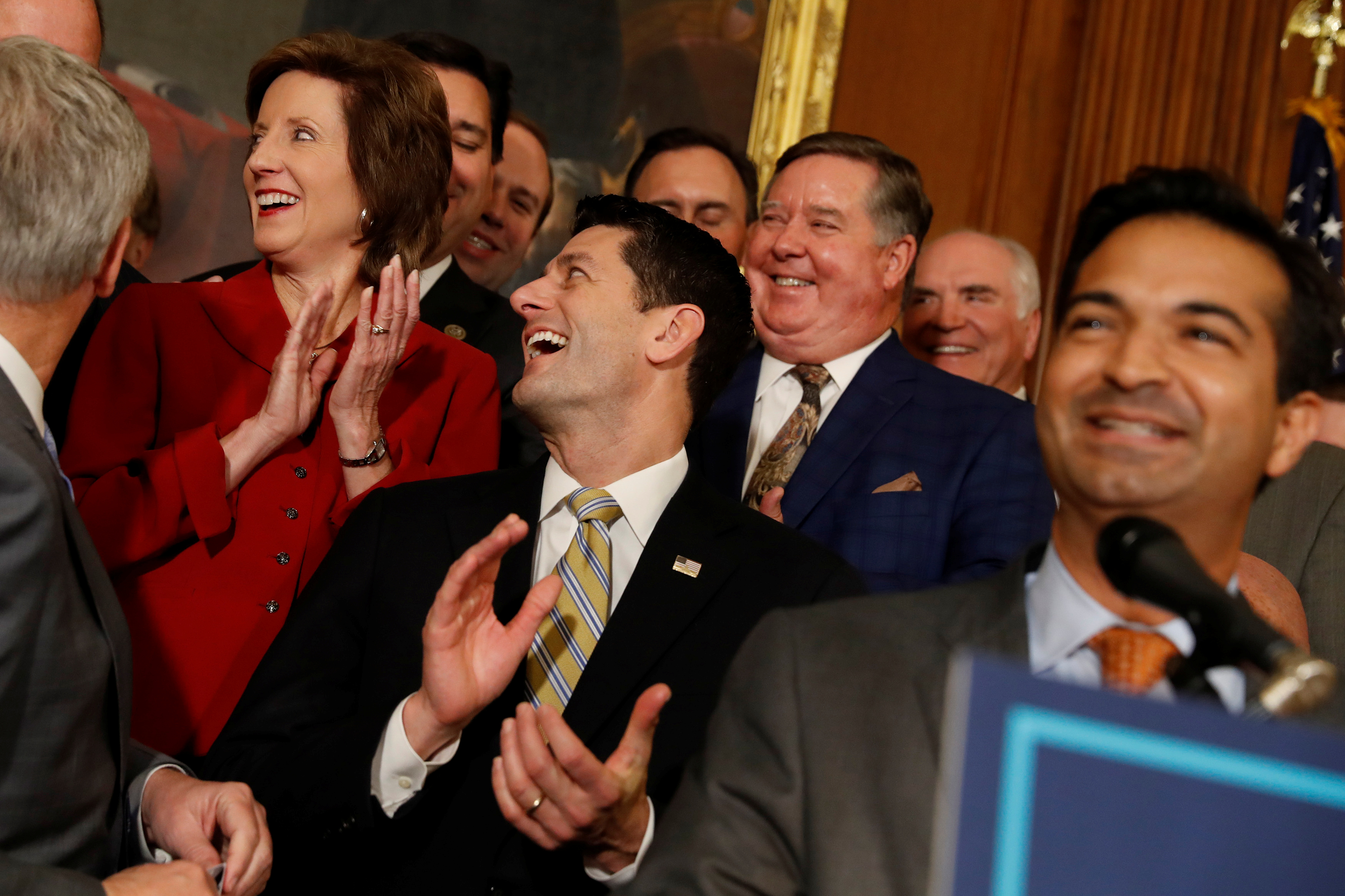 """House Republicans, including Speaker of the House Paul Ryan and Rep. Carlos Curbelo (R-FL), celebrate at a news conference announcing the passage of the """"Tax Cuts and Jobs Act"""" at the U.S. Capitol in Washington"""