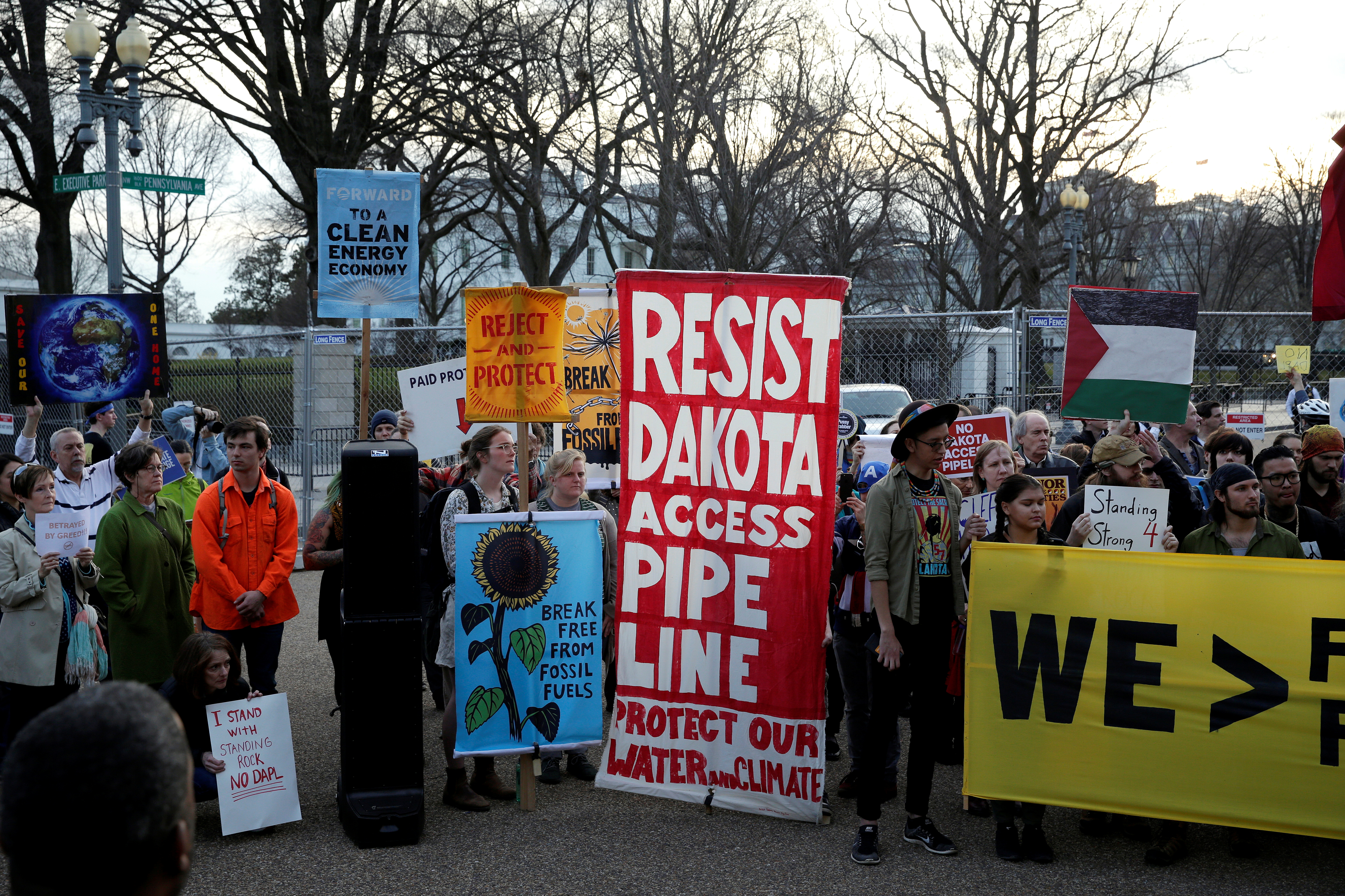 People protest against U.S. President Donald Trump's directive to permit the Dakota Access Pipeline during a demonstration at the White House in Washington, U.S., February 8, 2017. REUTERS/Joshua Roberts