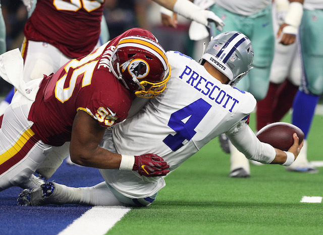 Da'Ron Payne #95 of the Washington Redskins sacks Dak Prescott #4 of the Dallas Cowboys in the first quarter of a football game at AT&T Stadium on November 22, 2018 in Arlington, Texas. (Photo by Richard Rodriguez/Getty Images)