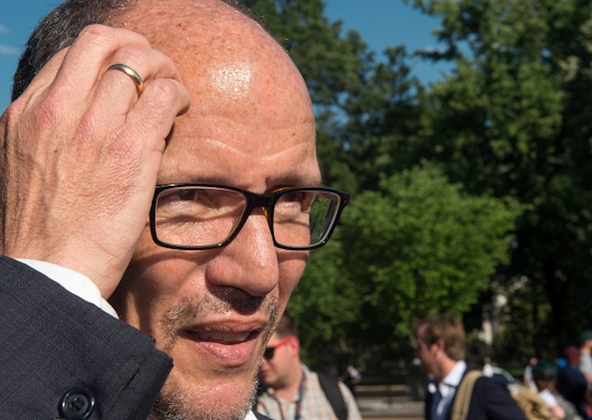 Democratic National Committee (DNC) Chairman Tom Perez delivers remarks to the media as a variety of protestors come together attending a demonstration in front of the White House in Washington, DC on June 1, 2017, objecting to US President Donald Trump's decision to withdraw from the Paris Climate accord. President Donald Trump declared that the United States will withdraw from the 2015 Paris accord and try to negotiate a new global deal on climate change. / AFP PHOTO / PAUL J. RICHARDS (Photo credit should read PAUL J. RICHARDS/AFP/Getty Images)