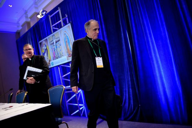 From left, Burlington Bishop Christopher Coyne, Indiana Bishop Timothy Doherty, chairman of the committee for the Protection of Children and Young People, and Galveston-Houston Cardinal Daniel DiNardo, President of the USCCB General Assembly, leave after a press conference at the annual US Conference of Catholic Bishops November 12, 2018 in Baltimore, Maryland. ( BRENDAN SMIALOWSKI/AFP/Getty Images)