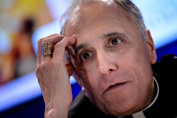 Galveston-Houston Cardinal Daniel DiNardo, President of the USCCB General Assembly, listens during a press conference at the annual US Conference of Catholic Bishops November 12, 2018 in Baltimore, Maryland. (BRENDAN SMIALOWSKI/AFP/Getty Images)