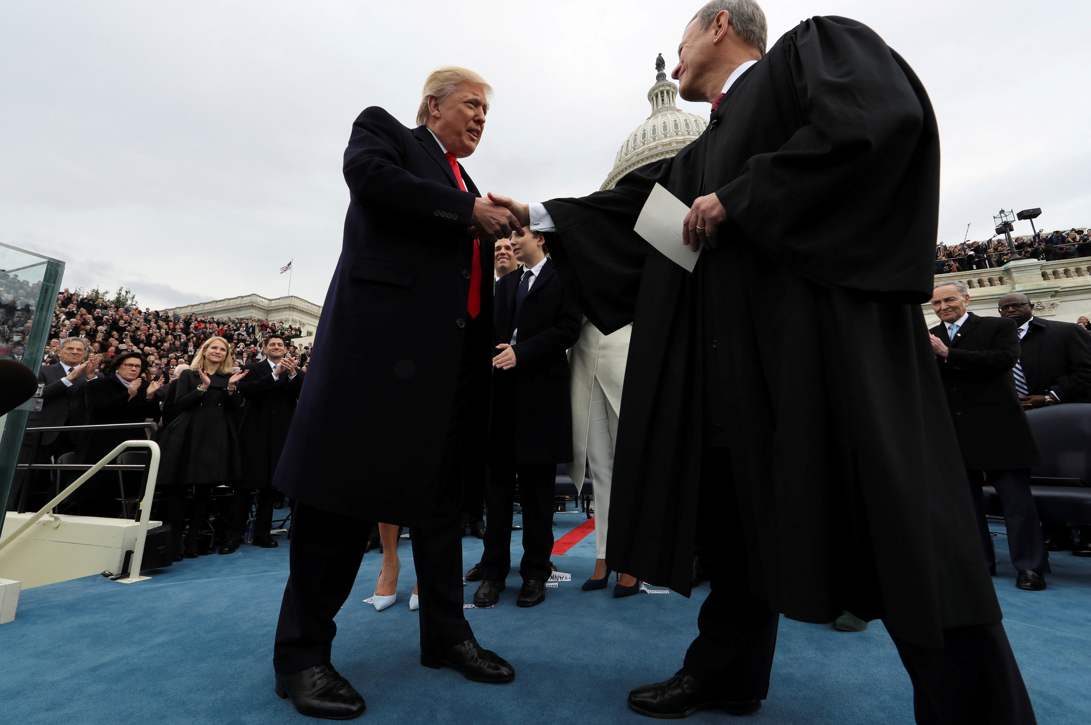 FILE PHOTO: President Donald Trump and U.S. Supreme Court Chief Justice John Roberts shake hands after Trump took the oath of office during inauguration ceremonies swearing in Trump as the 45th president of the United States on the West front of the U.S. Capitol in Washington, D.C., January 20, 2017. REUTERS/Jim Bourg/File Photo
