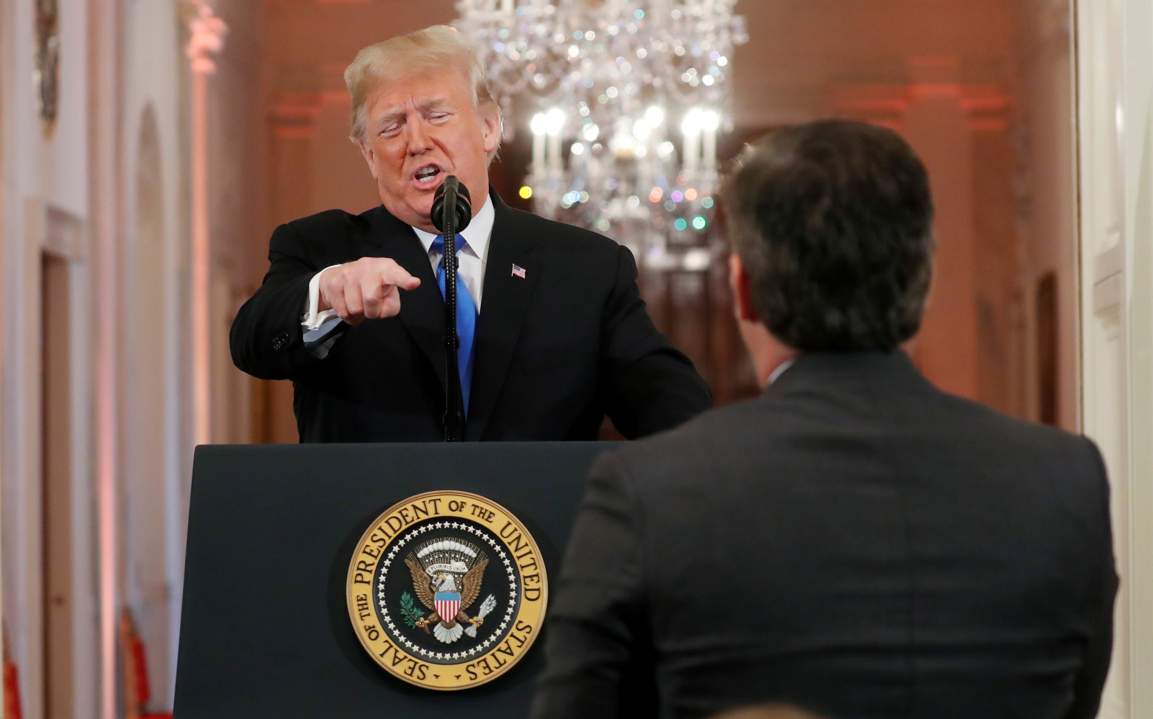 "President Donald Trump points at CNN's Jim Acosta and accuses him of ""fake news"" while taking questions during a news conference following Tuesday's midterm congressional elections at the White House in Washington, November 7, 2018. REUTERS/Kevin Lamarque"