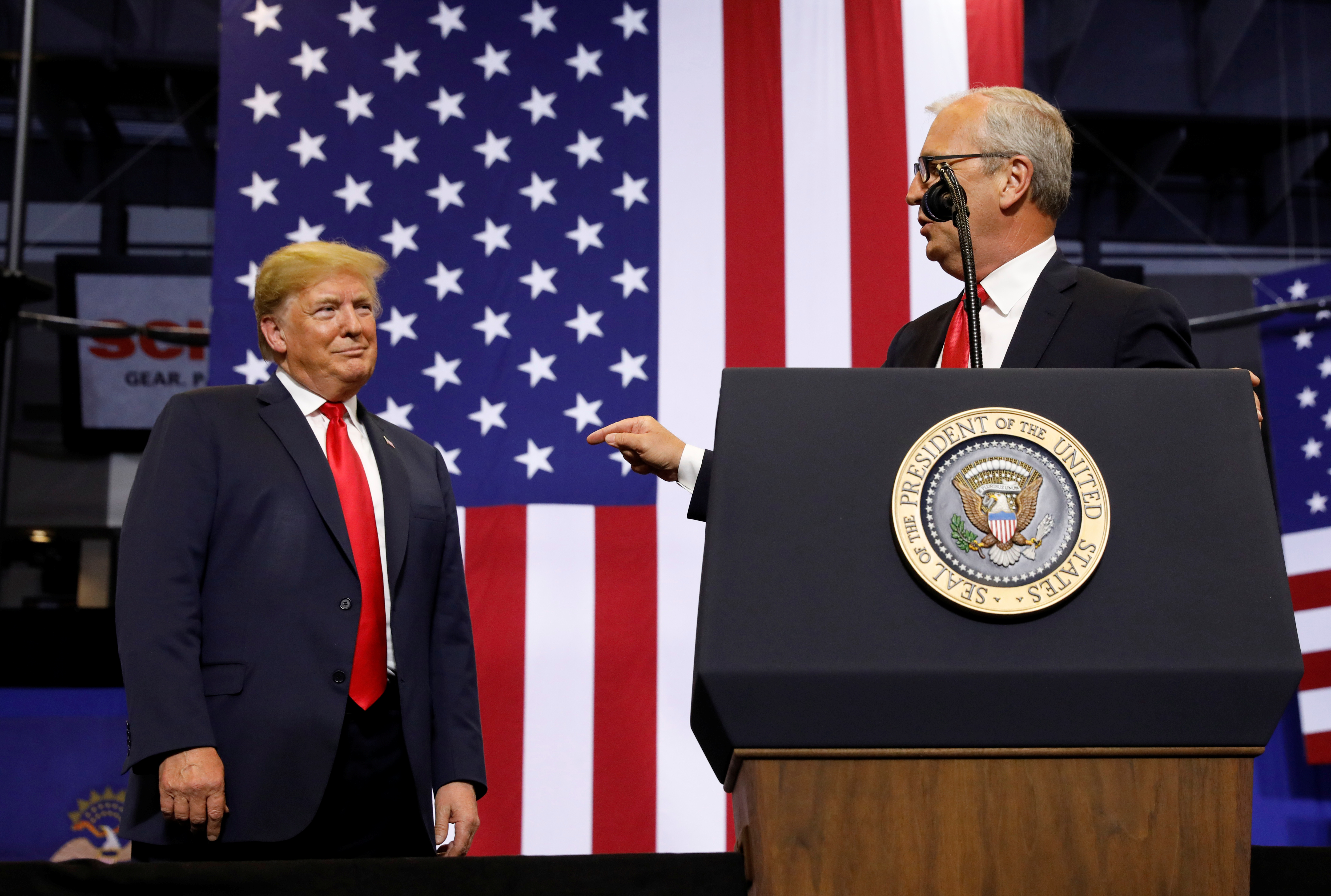 U.S. President Donald Trump listens at a rally in support of Rep. Kevin Cramer (R) in his run for Senate in Fargo, North Dakota, U.S., June 27, 2018. REUTERS/Kevin Lamarque