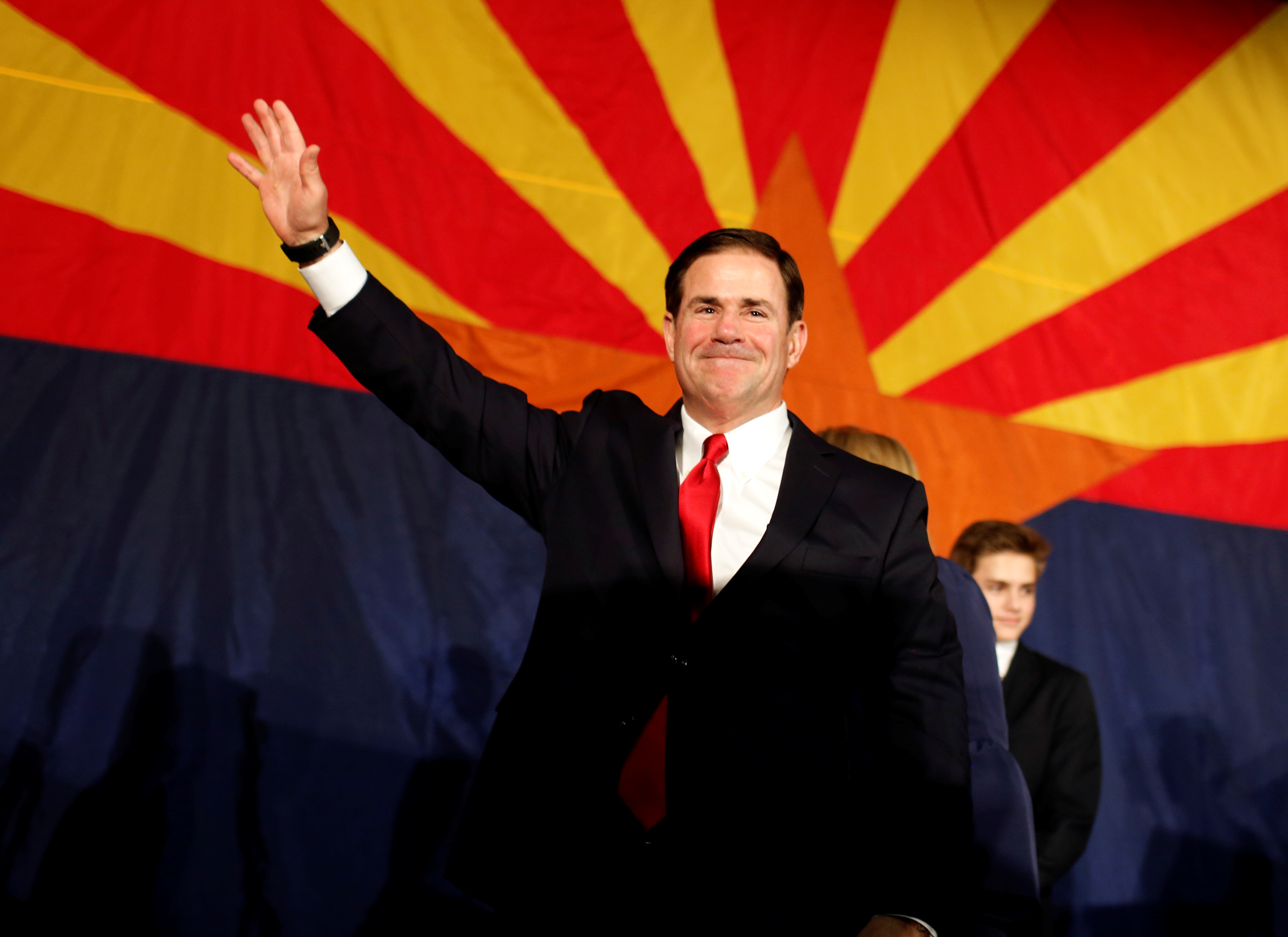 Arizona Gov. Doug Ducey greets the GOP midterm elections watch party after being re-elected in Phoenix, Arizona, U.S. November 6, 2018. REUTERS/Nicole Neri