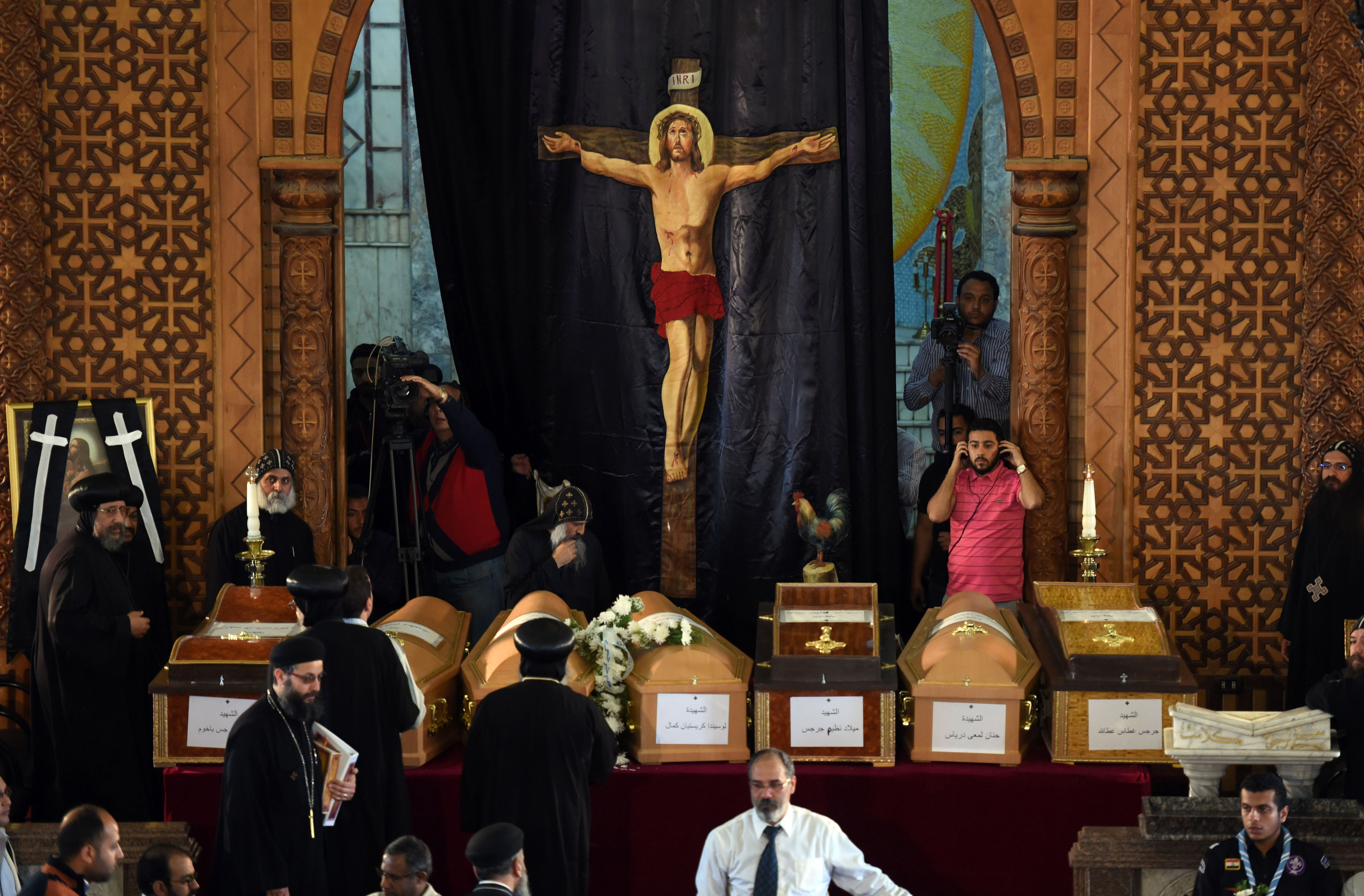 Coptic priests stand near the coffins of victims of the blast at the Coptic Christian Saint Mark's church in Alexandria the previous day during a funeral procession at the Monastery of Marmina in the city of Borg El-Arab, east of the northern port city on April 10, 2017. Egypt prepared to impose a state of emergency after jihadist bombings killed dozens at two churches in the deadliest attacks in recent memory on the country's Coptic Christian minority. (MOHAMED EL-SHAHED/AFP/Getty Images)