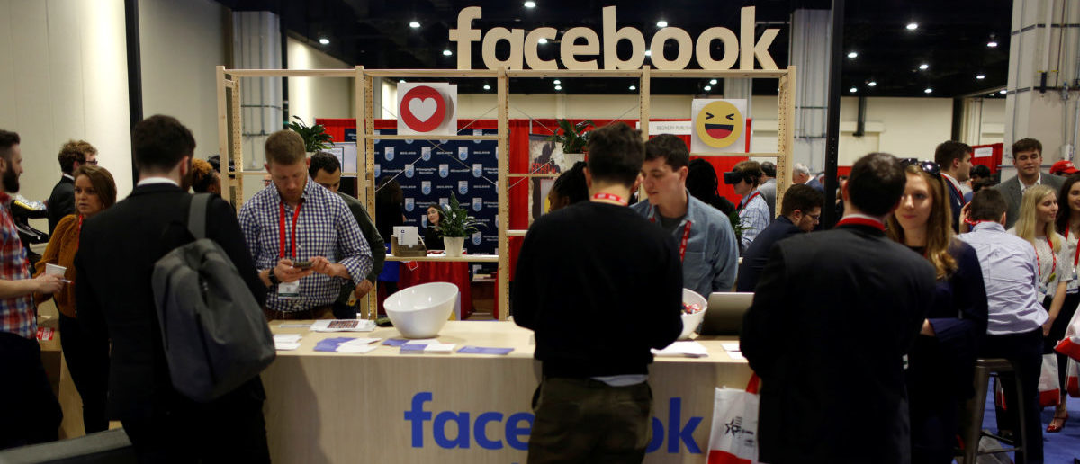 People stop at the Facebook booth at the Conservative Political Action Conference (CPAC) at National Harbor, Maryland, U.S., February 23, 2018. REUTERS/Joshua Roberts